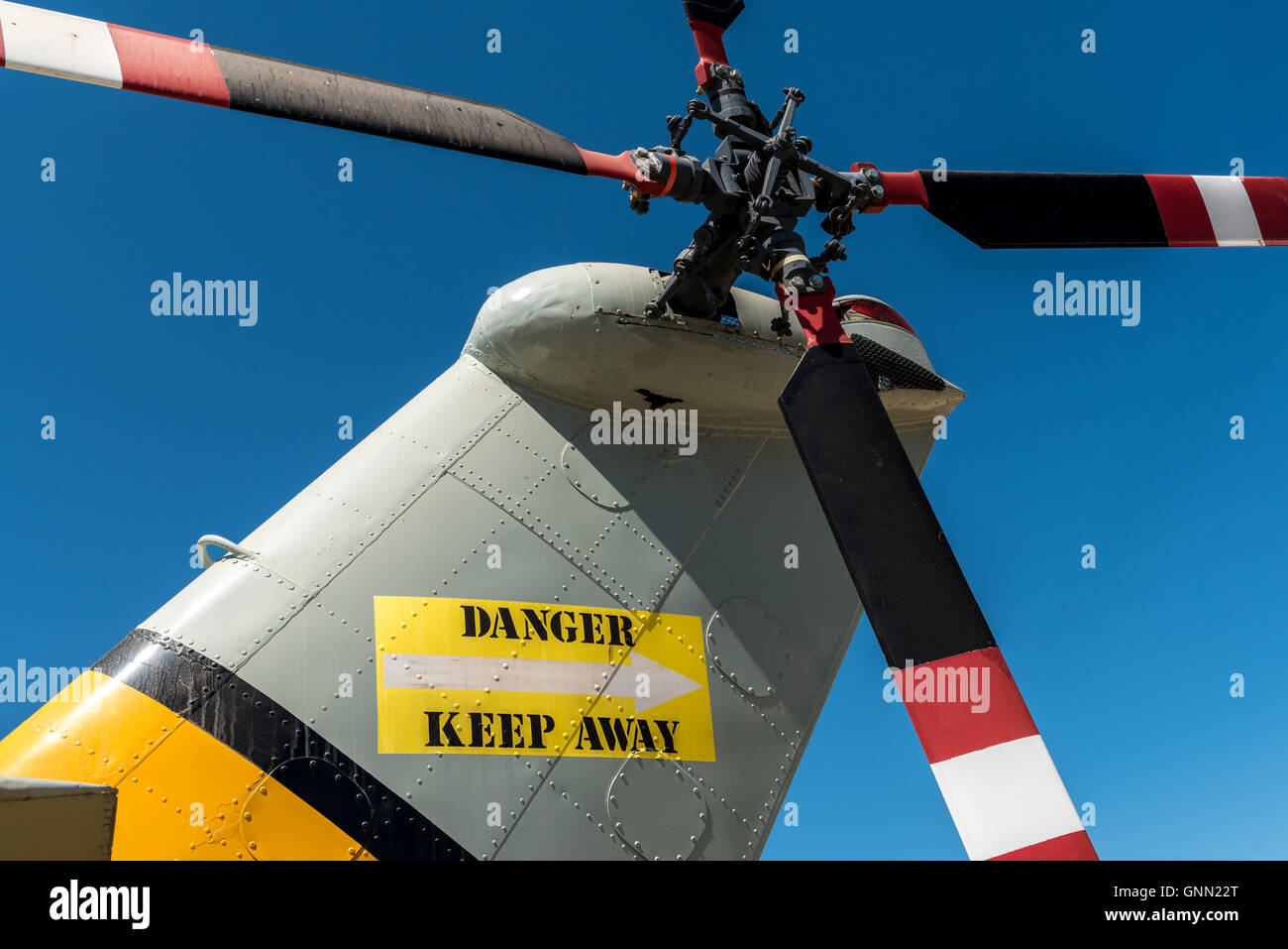 Helicopter tail and rotor with appropriate warning - Stock Image