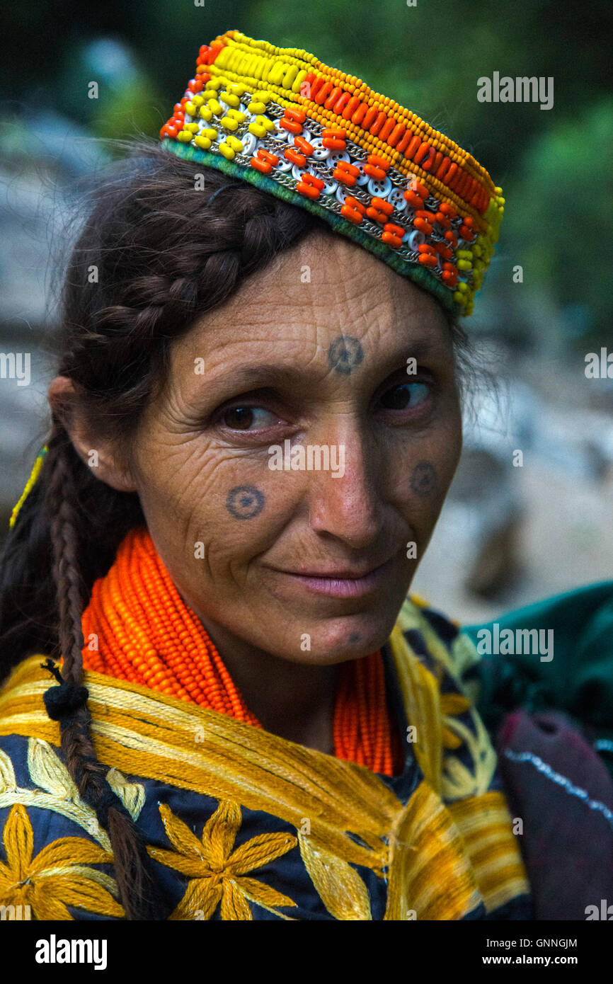 Beautiful Kalasha Woman With Tattoos On Her Face Smiles Whilst