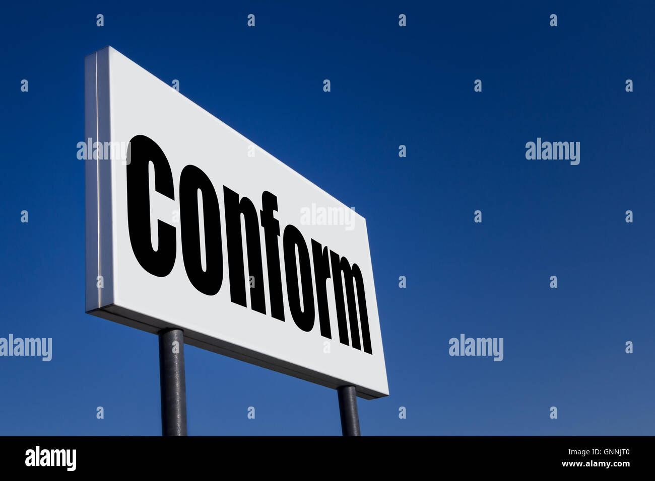 Big ad panel, embossed with the message 'CONFORM', against blue sky. - Stock Image