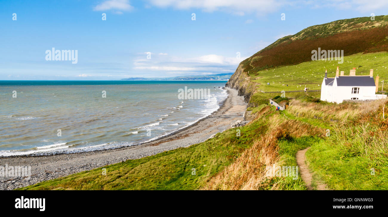 View of a house on the coast near Aberystwyth in Wales, UK - Stock Image