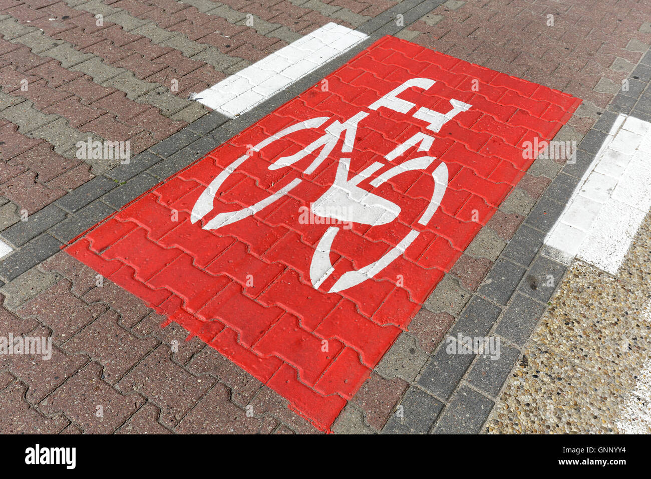 Bike lane sign it is marked on the road - Stock Image