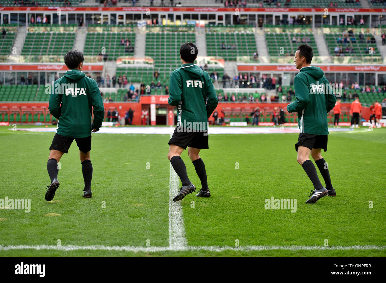 WROCLAW, POLAND - MARCH 26, 2016: Referee's warm-up before International Football friendly match Poland vs Finland - Stock Image