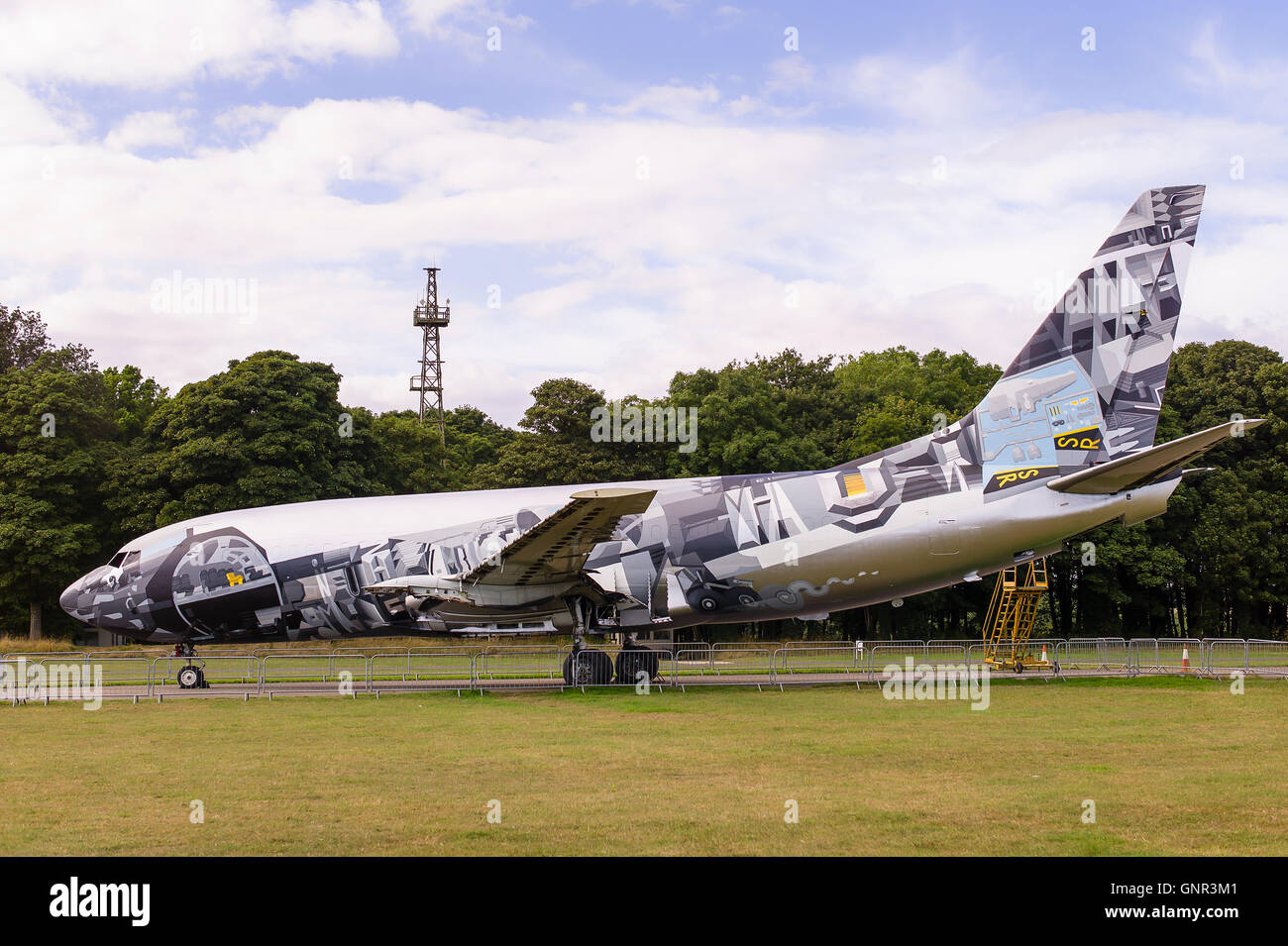 A retired civil airliner painted by art students as a project - Stock Image