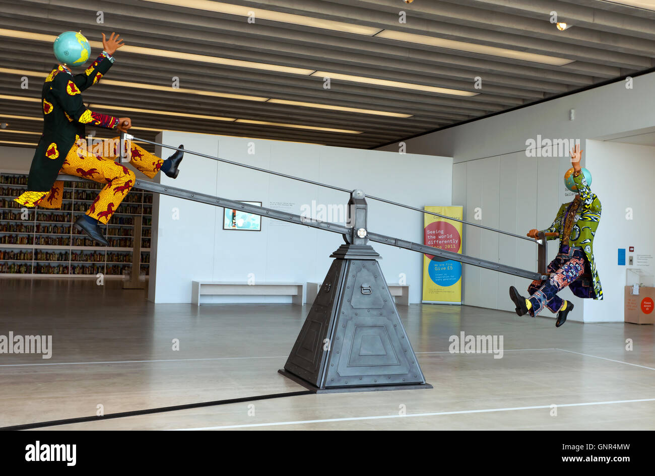 Image showing 'End of Empire' a  Kinetic Sculpture by Yinka Shonibare, in the Sunley Gallery of the Turner - Stock Image