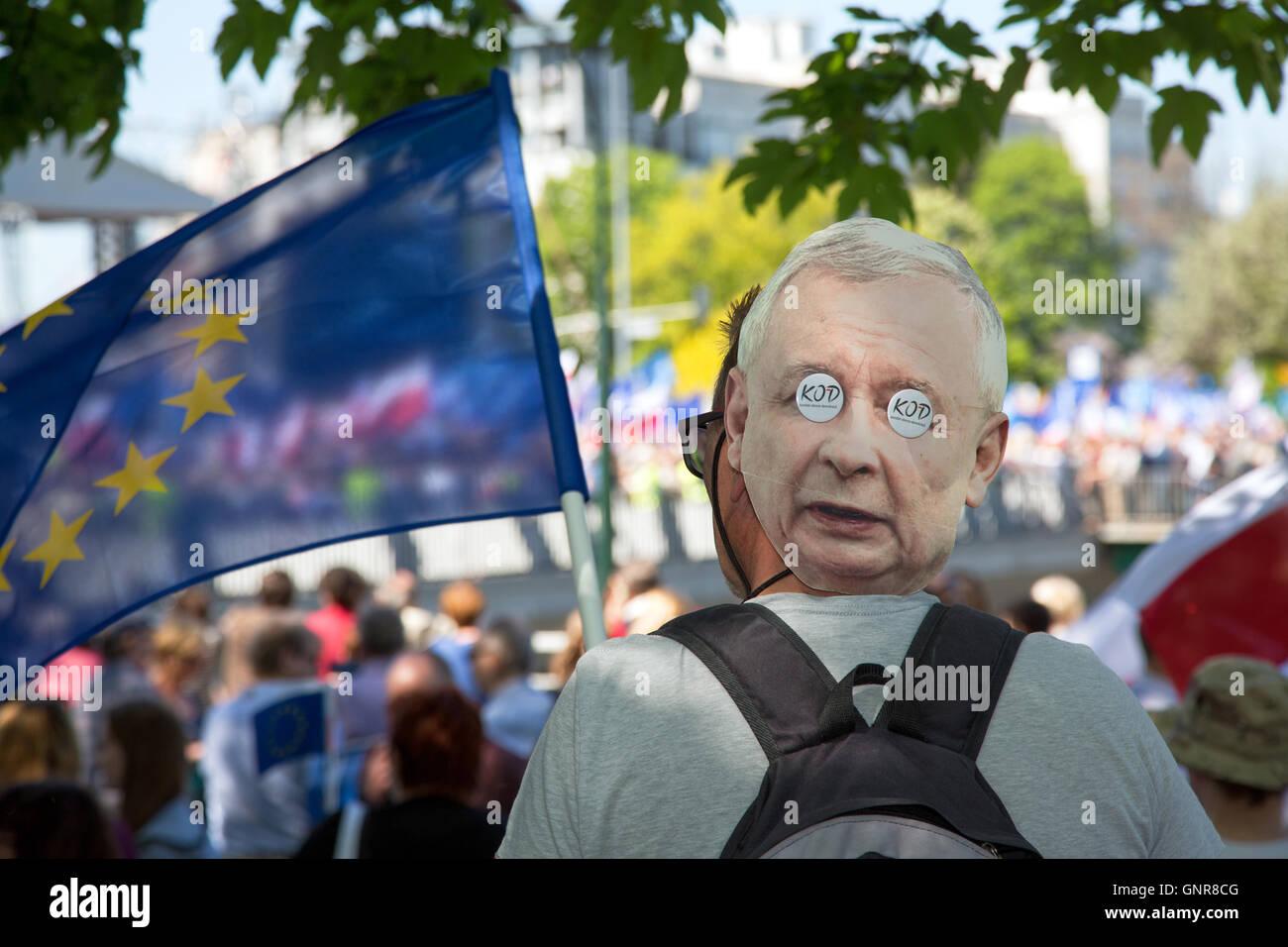 Warsaw, Poland, Protestor with Kaczynski mask at the back - Stock Image