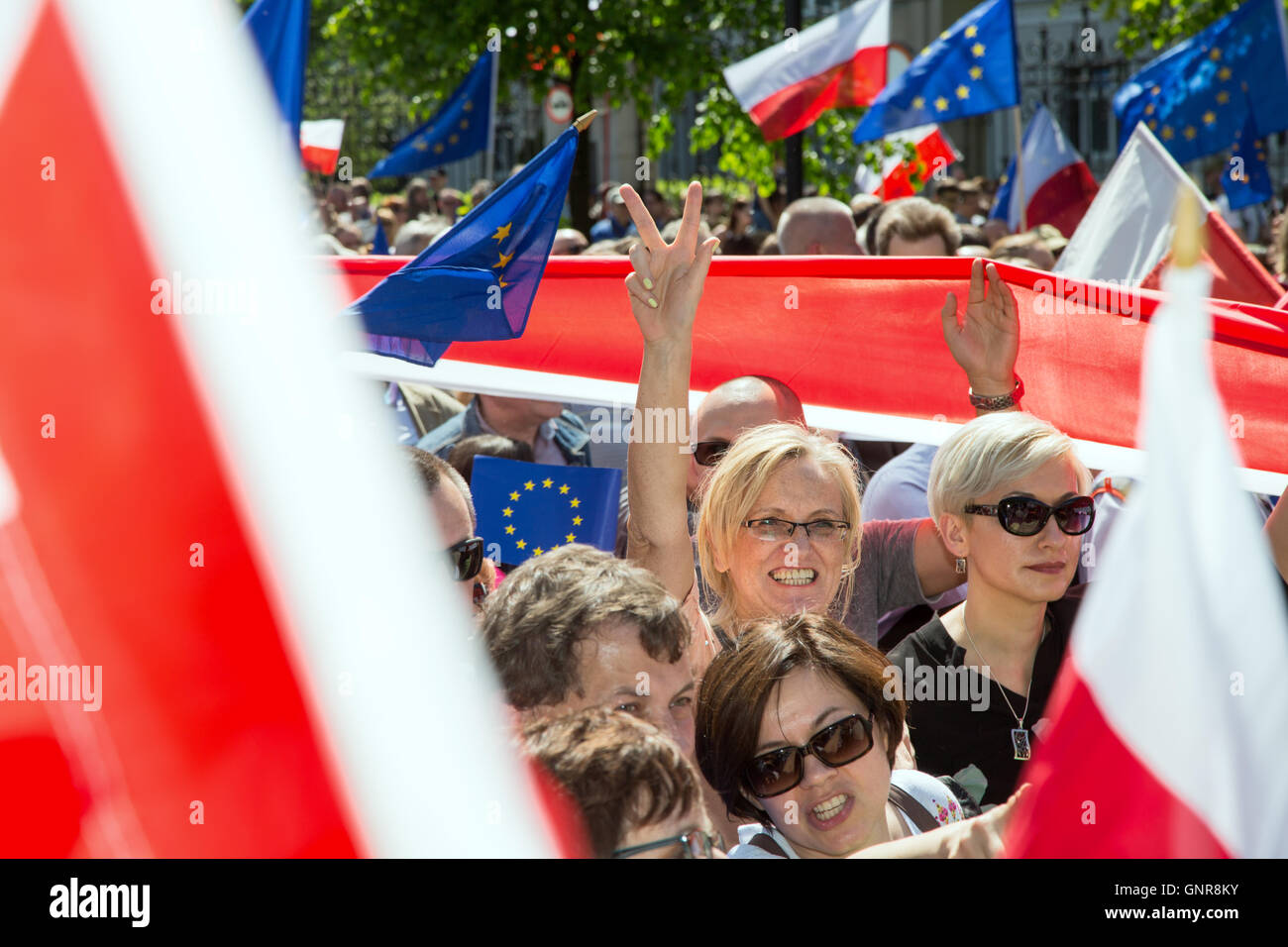 Warsaw, Poland, demonstrators with Polish and European flags - Stock Image