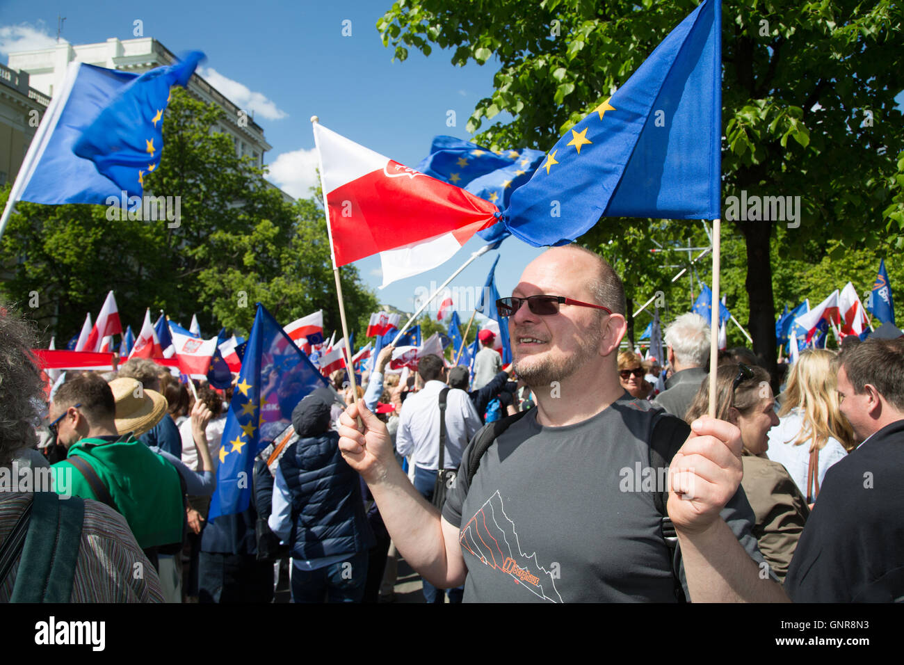 Warsaw, Poland, Protestor with Poland- us Europafahne - Stock Image
