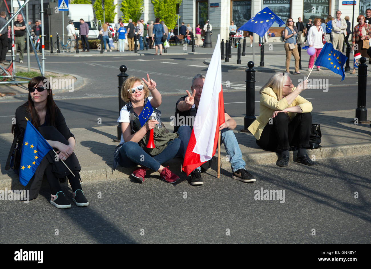 Warsaw, Poland, demonstrators with Polish and European flags are resting - Stock Image