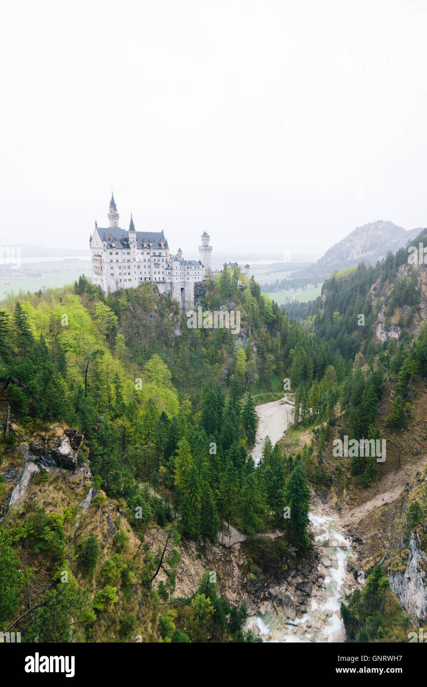 Fussen, Germany - May 01, 2015: Neuschwanstein Castle a foggy day. It  is a nineteenth-century Romanesque Revival - Stock Image