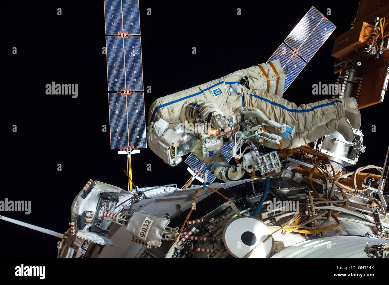 Russian cosmonaut Oleg Artemyev of International Space Station Expedition 40 during a spacewalk in his Russian Orlan - Stock Image