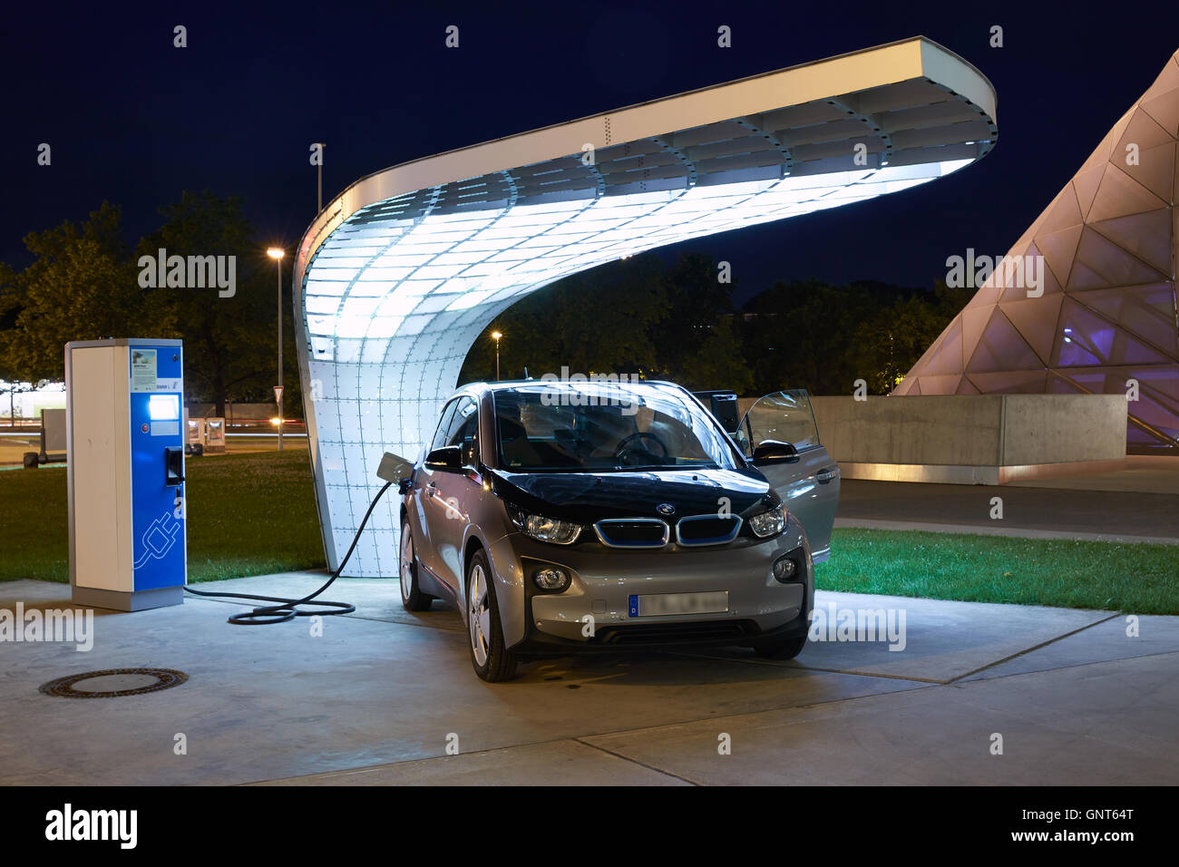 Muenchen, Germany, an electric vehicle at a Ladesaeule - Stock Image