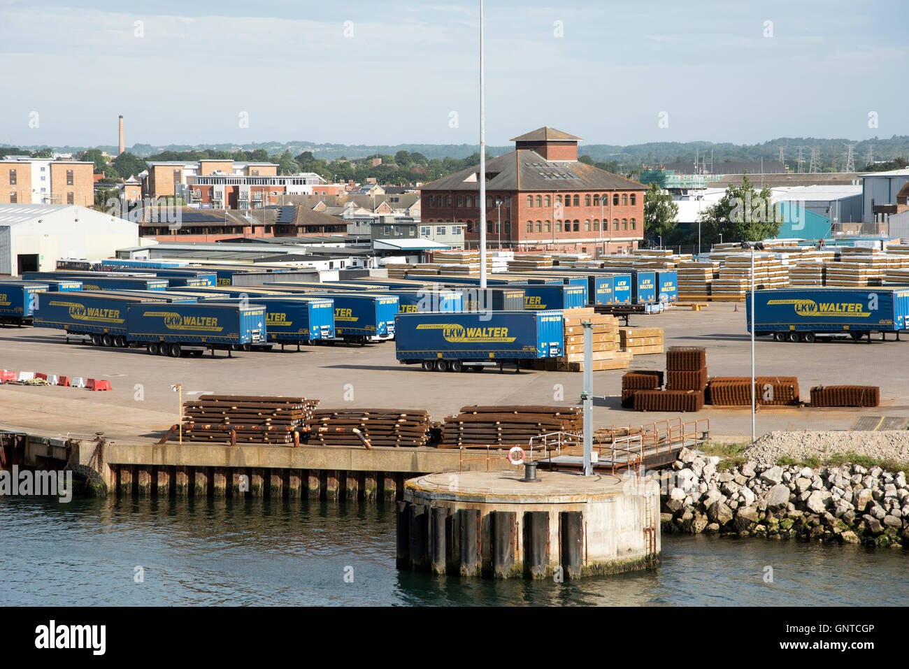 Poole Harbour Dorset UK - Commercial cargo carrying trailers parked on the quay - Stock Image