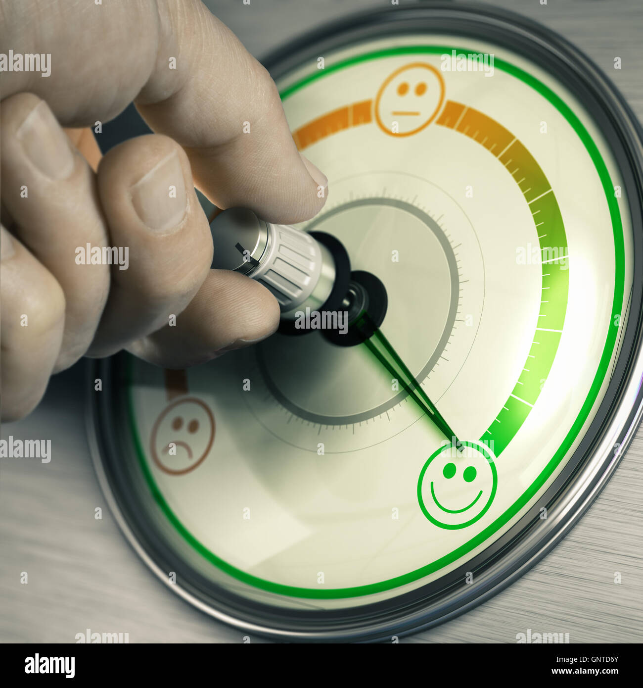 Close-up of a hand turning the knob of a customer feedback device to the highest position. Concept of good mood Stock Photo