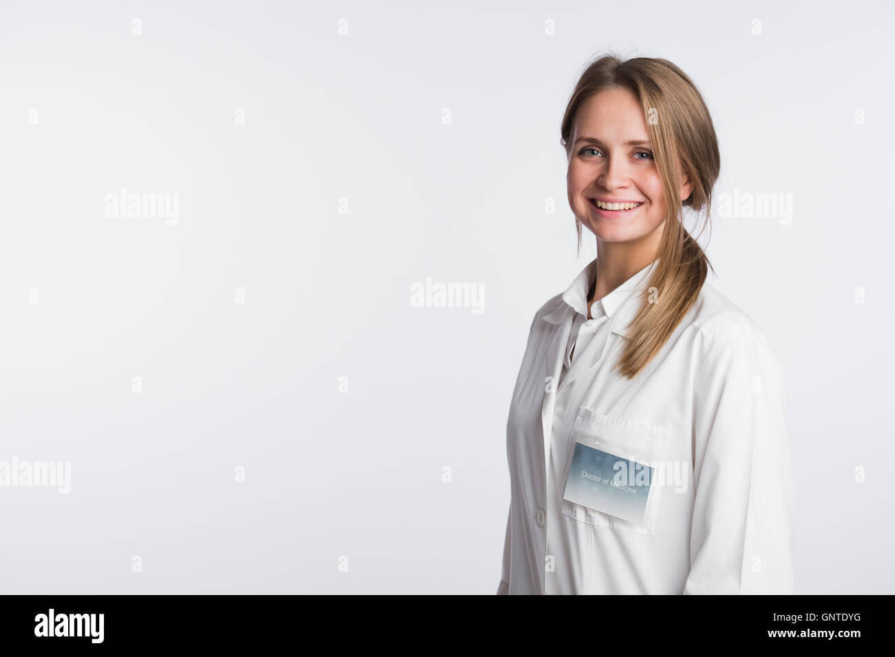 Beautiful nurse portrait on white with copy space - Stock Image