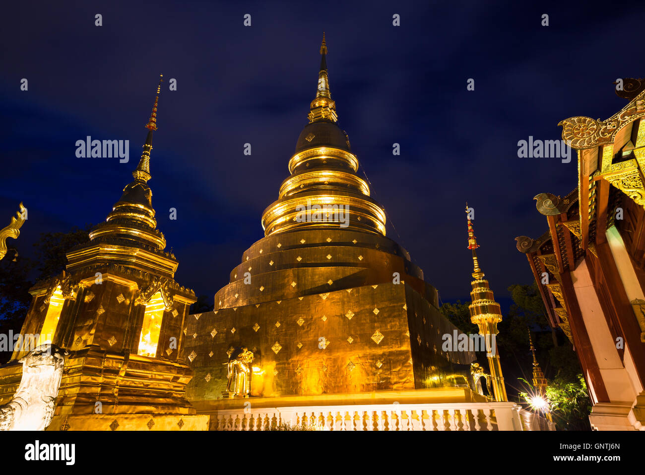 Golden stupa of Wat Phra Singh at dusk, Chiang Mai, Thailand - Stock Image
