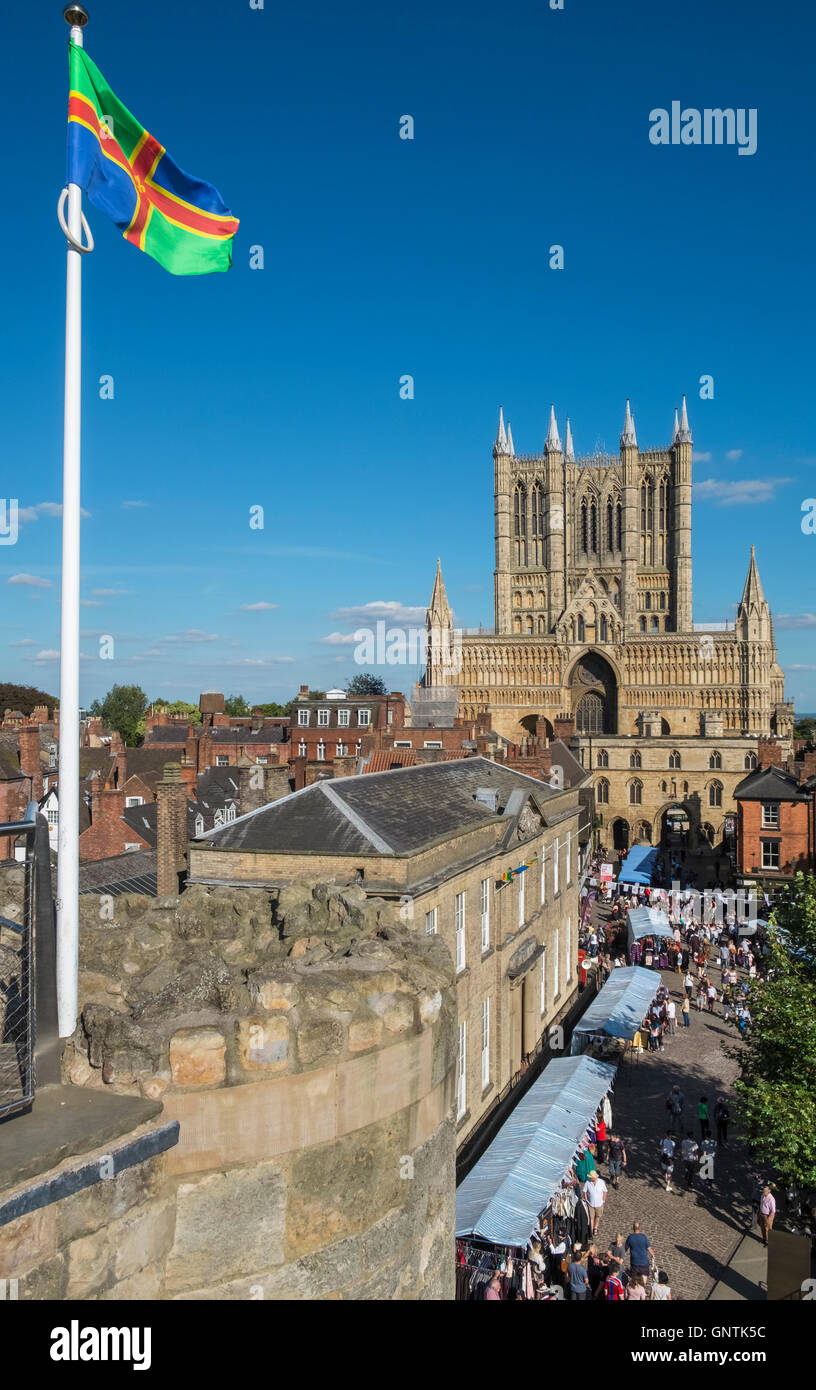 Historic City of Lincoln, UK, with Lincoln Cathedral in the background, and the county of Lincolnshire flag in the Stock Photo