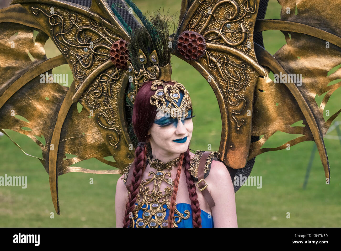 Participant with elaborate headdress and costume at the 2016 Steampunk Festival, City of Lincoln, UK - Stock Image