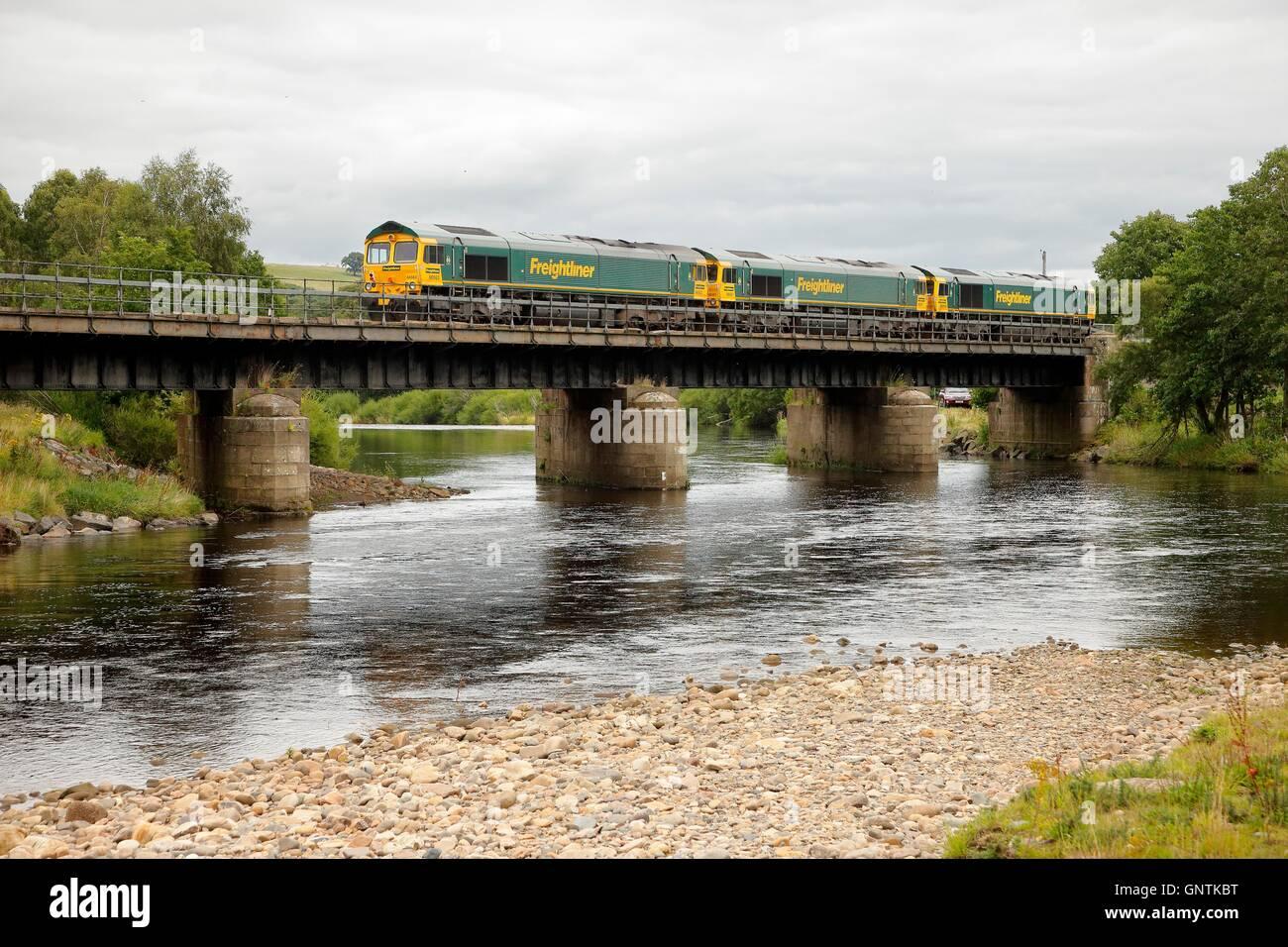 Class 66 Freightliner freight trains. South Tyne, Ridley Hall Railway Bridge, Bardon Mill, Newcastle & Carlisle - Stock Image