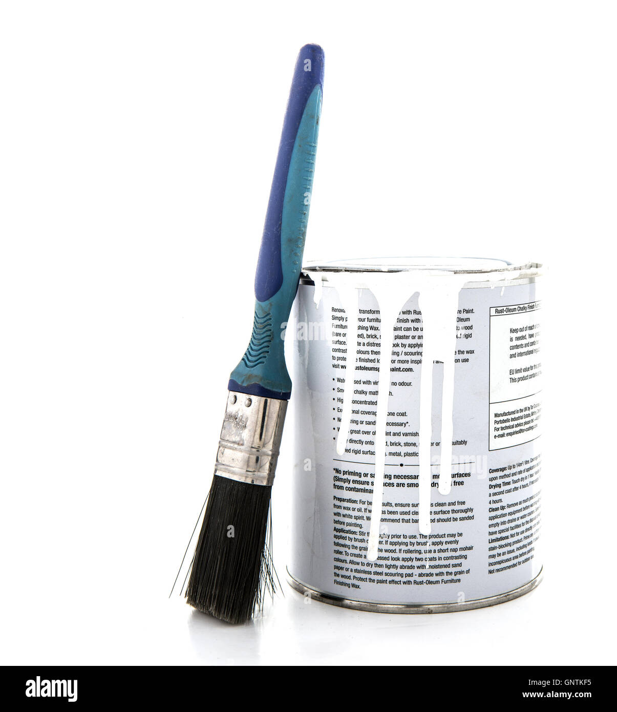 Tin of Rust-oleum Chalky Finish Furniture Paint with Brush on a White Background - Stock Image