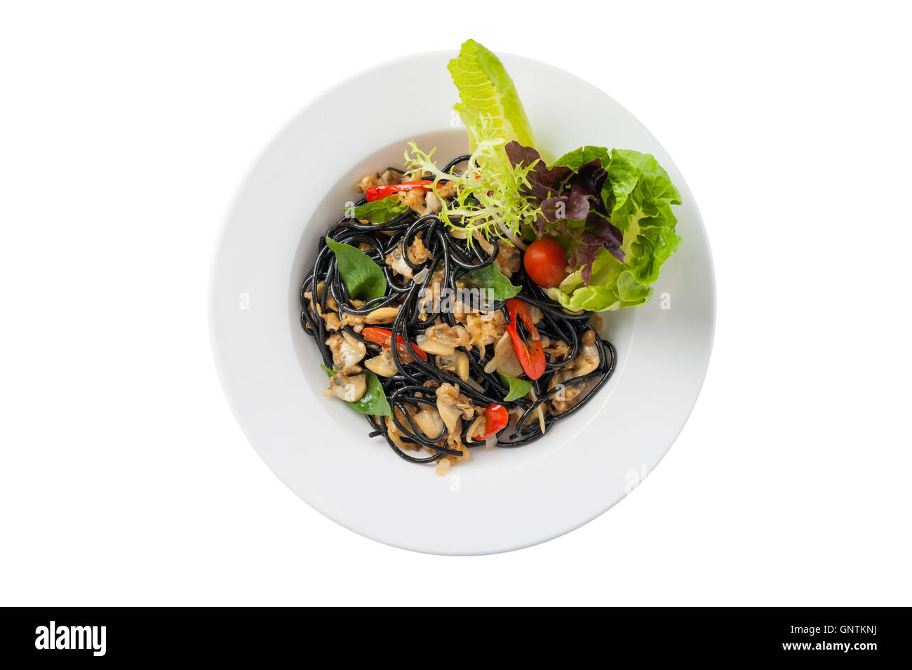 Top view of Italian and Thai fusion food style spicy black pasta ...