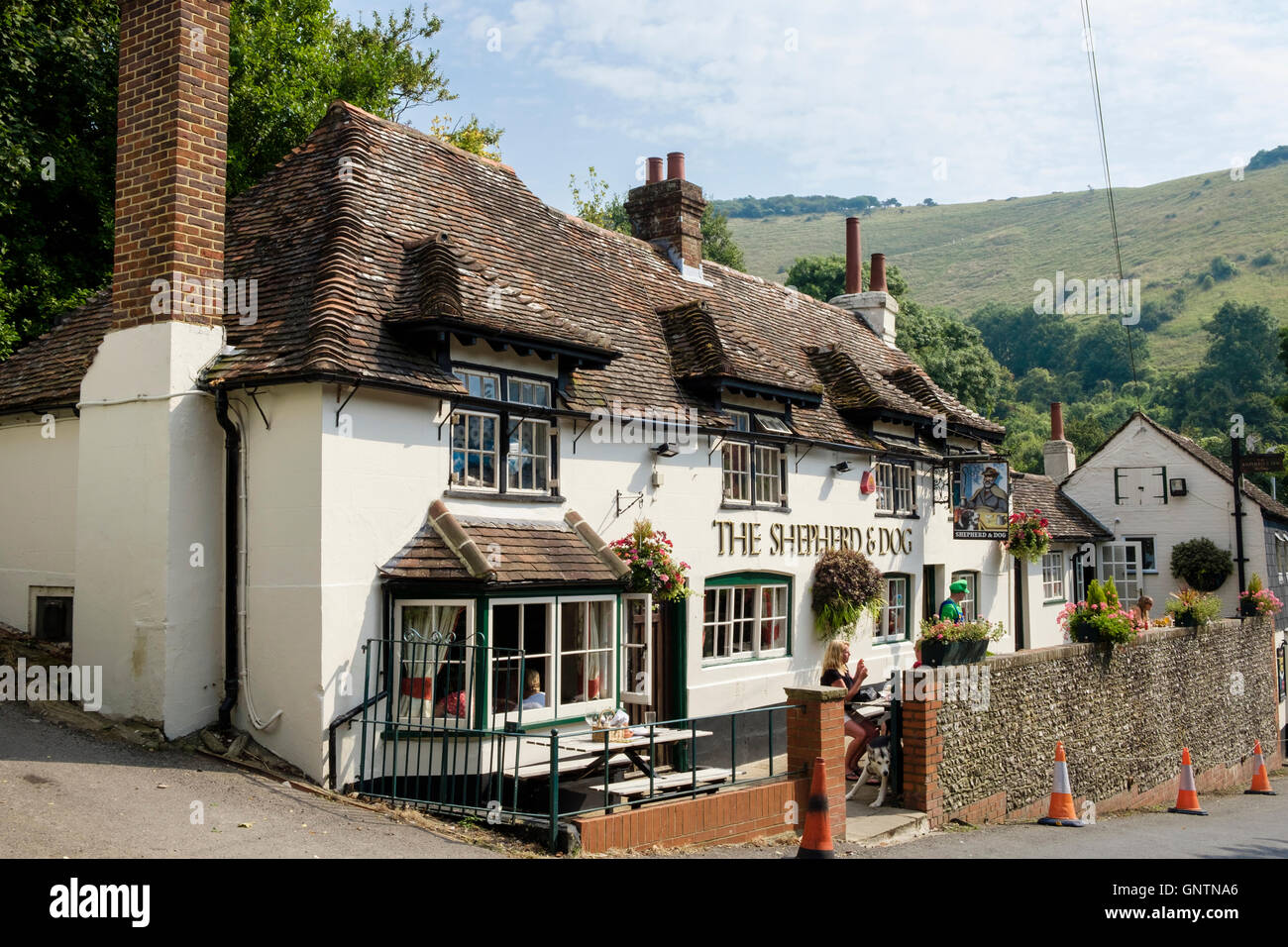 The Shepherd and Dog 18th century country pub below Fulking escarpment in South Downs National Park. Fulking West Stock Photo