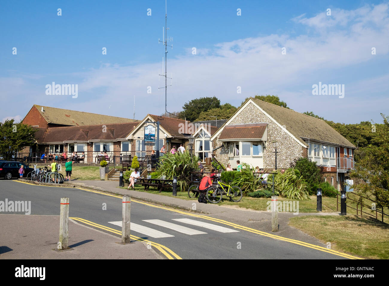 Devils Dyke pub with people dining out in the South Downs National Park. Brighton, West Sussex, England, UK, Britain - Stock Image