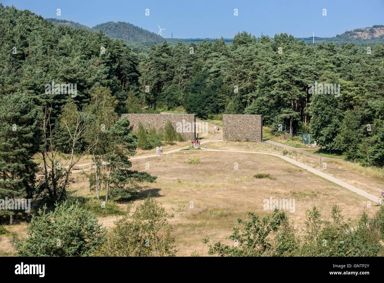 Tourists walking through entrance gate of the Mechelse Heide, heathland in the Hoge Kempen National Park, Limburg, - Stock Image
