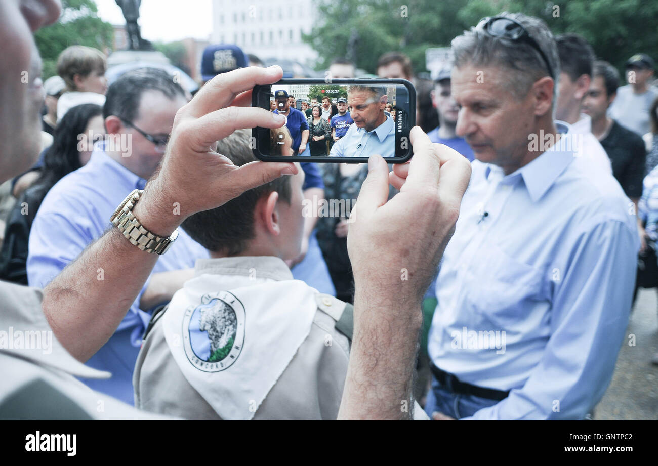 A Boy Scout's father records his son asking Libertarian U.S. presidential candidate Gary Johnson a question. - Stock Image