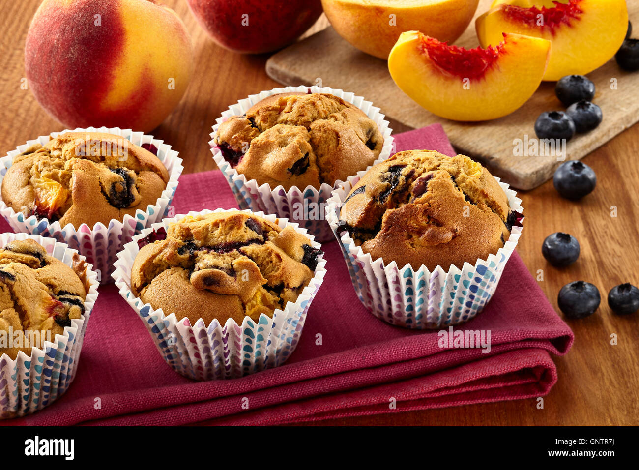 Peachy blueberry muffins - Stock Image
