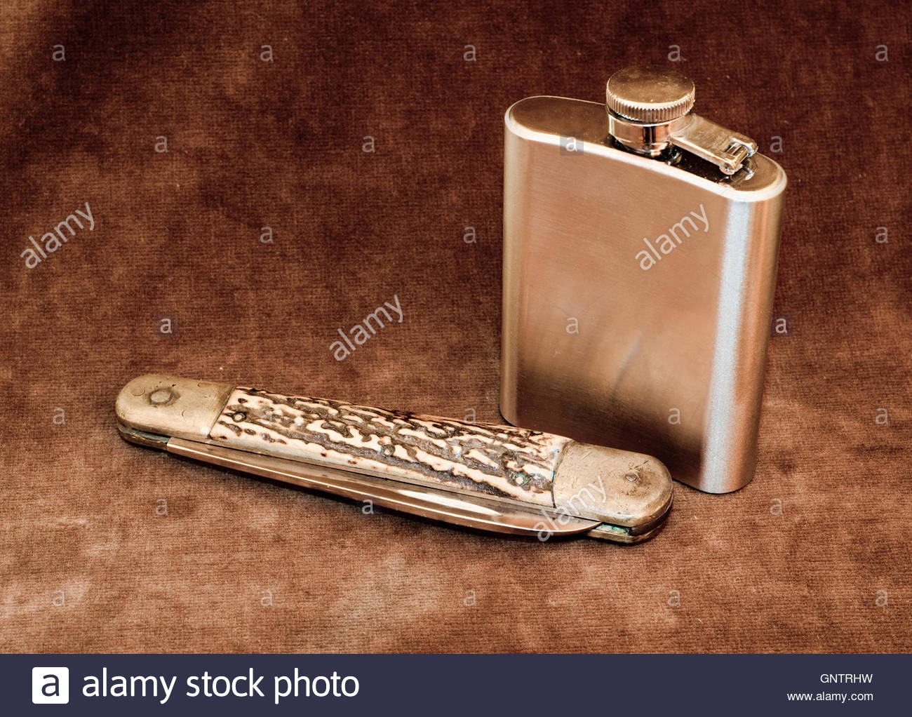 Pocket Knife and Hip Flask - Stock Image