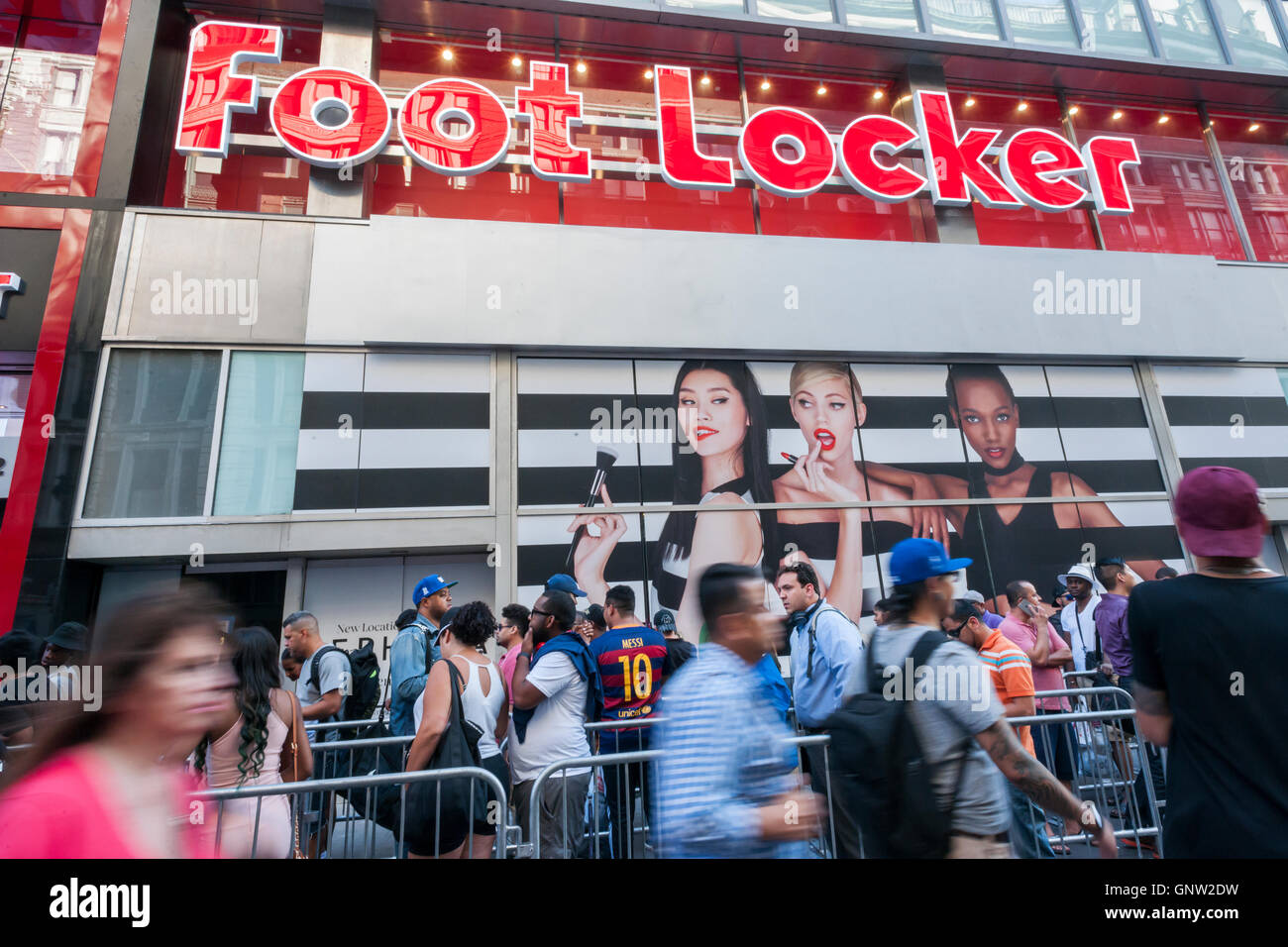 Hordes of shoppers outside the new experiential Foot Locker store in Herald Square in New York on opening day, Tuesday, - Stock Image