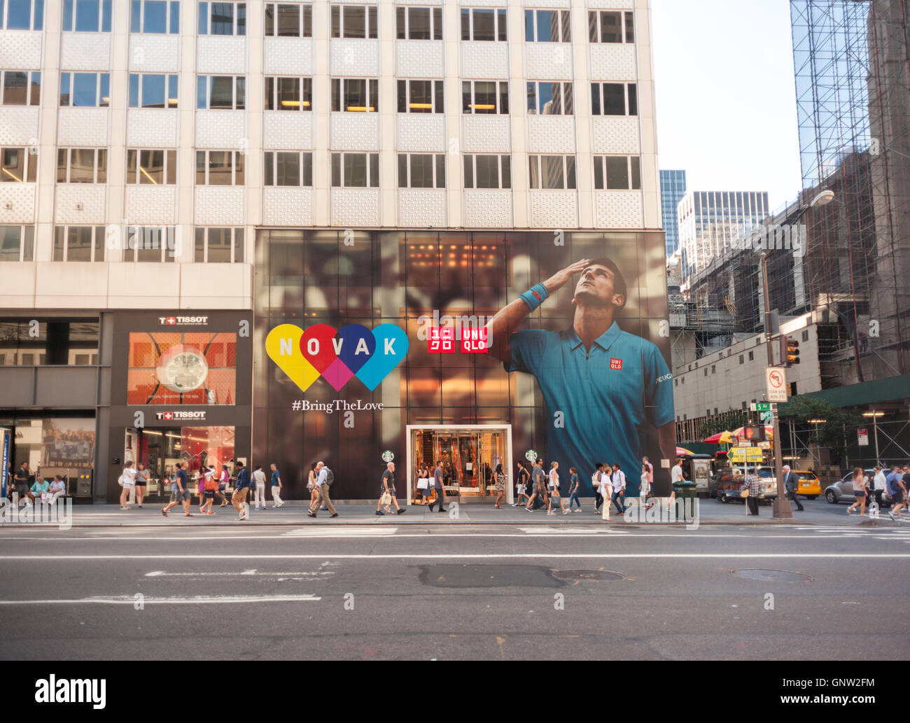 The Uniqlo store on Fifth Avenue in New York is decorated with a mural feating top seed tennis player Novak Djokovic, - Stock Image