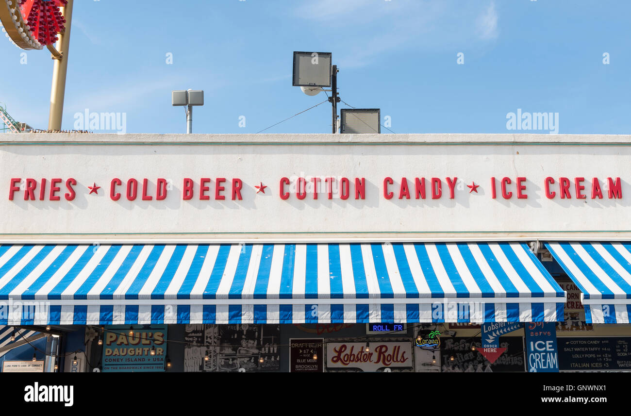 Front exterior of clam bar restaurant with signage and traditional blue and white striped awning, Coney Island, - Stock Image