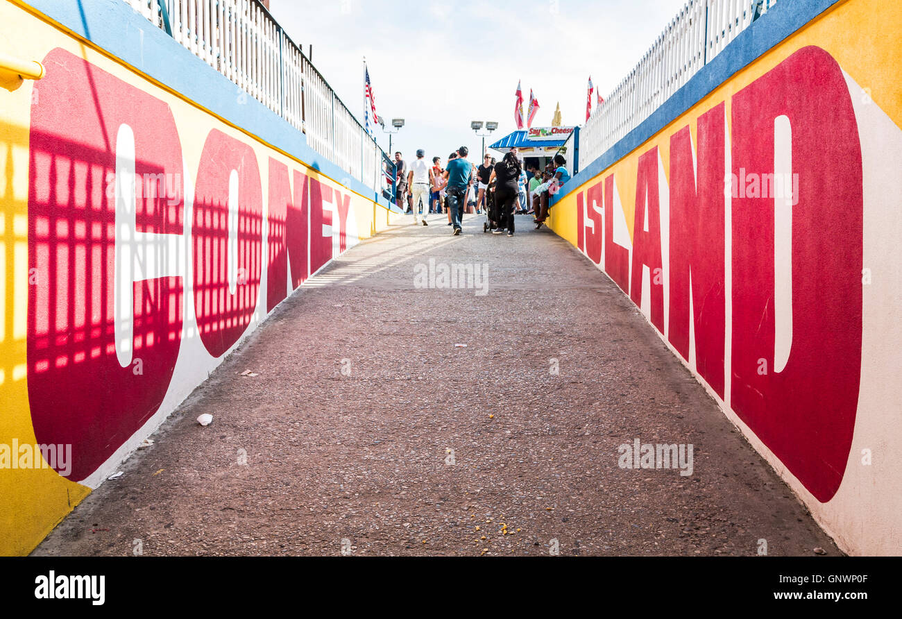 Lettering / signage of a graffiti mural on Coney Island boardwalk at the entrance to Deno's Wonder Wheel amusement - Stock Image