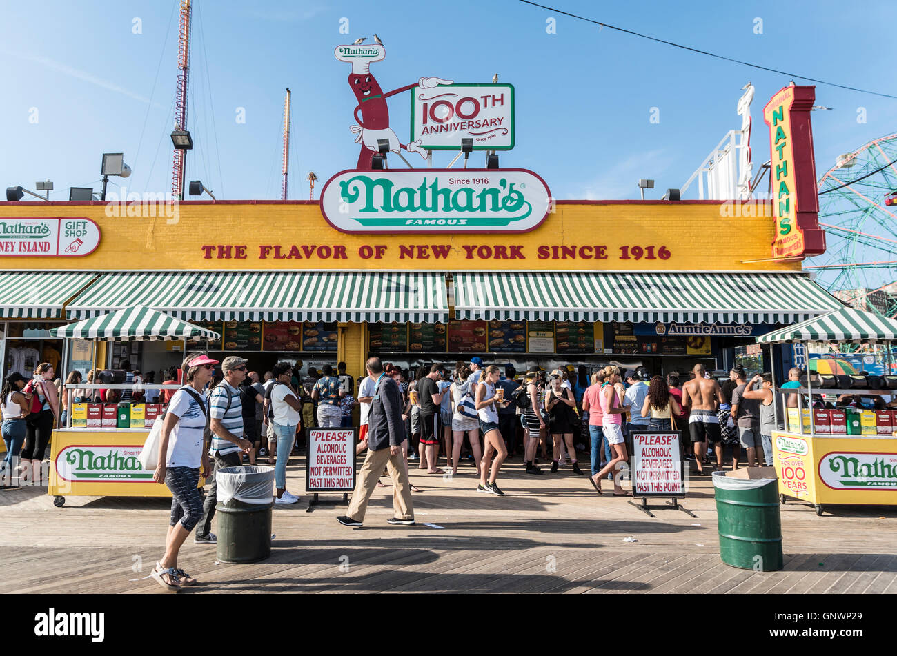 Exterior view of iconic Nathan's Famous hotdog joint on Coney Island boardwalk in Summer, New York. - Stock Image