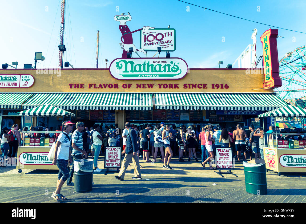 Exterior view of iconic Nathan's Famous hotdog joint on Coney Island boardwalk in Summer, New York in vintage - Stock Image