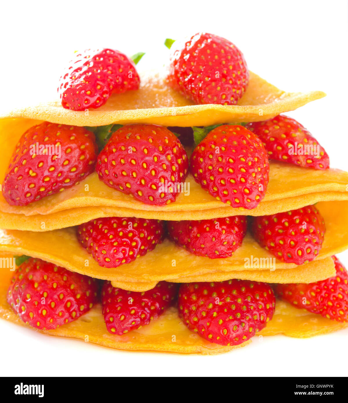 Pancakes and strawberry with syrup - Stock Image