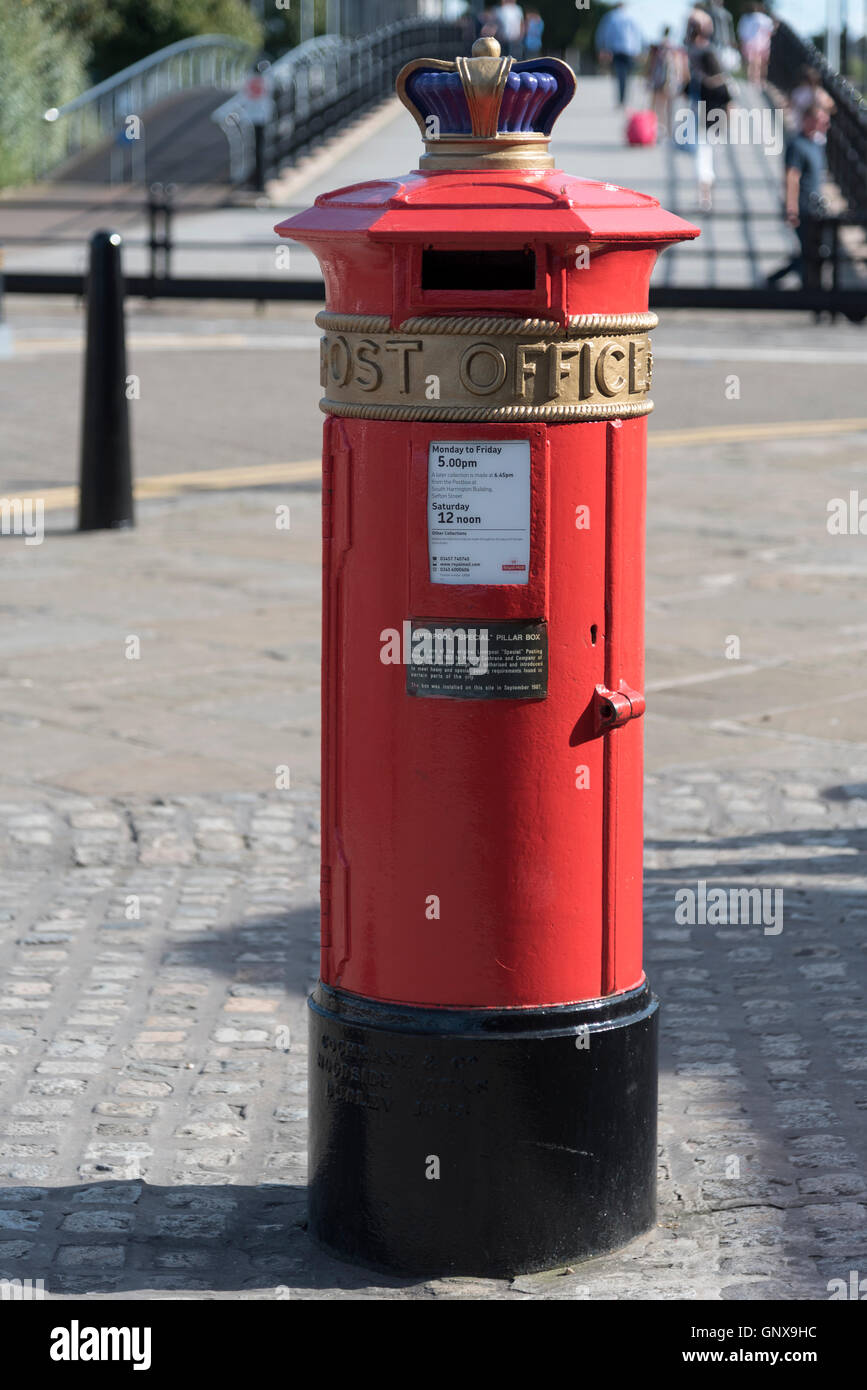 A Liverpool Special pillar box with Crown on top. - Stock Image