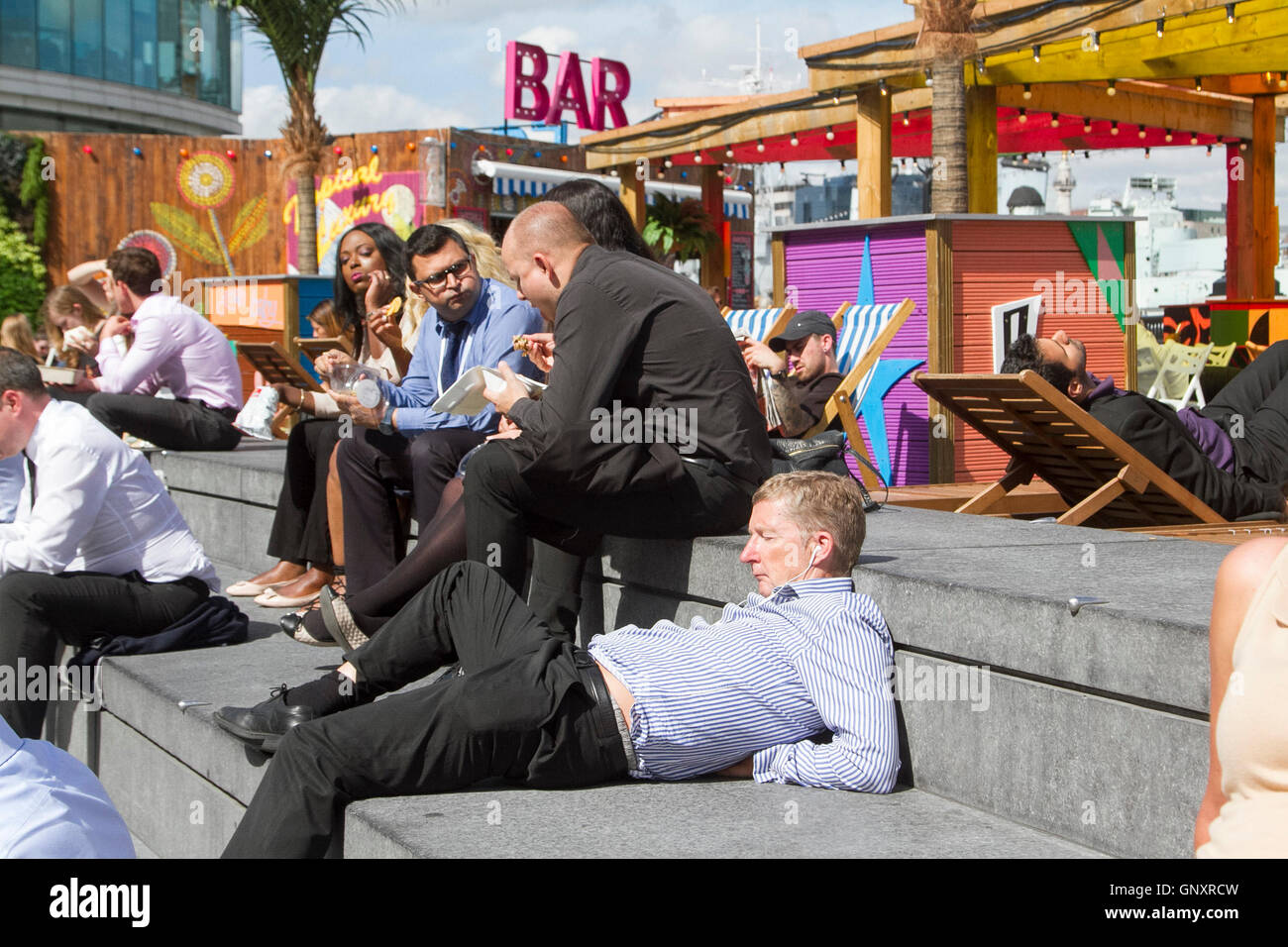 London, UK. 1st Sep, 2016. A man snoozes in the sunshine on London Riverside Credit:  amer ghazzal/Alamy Live News - Stock Image