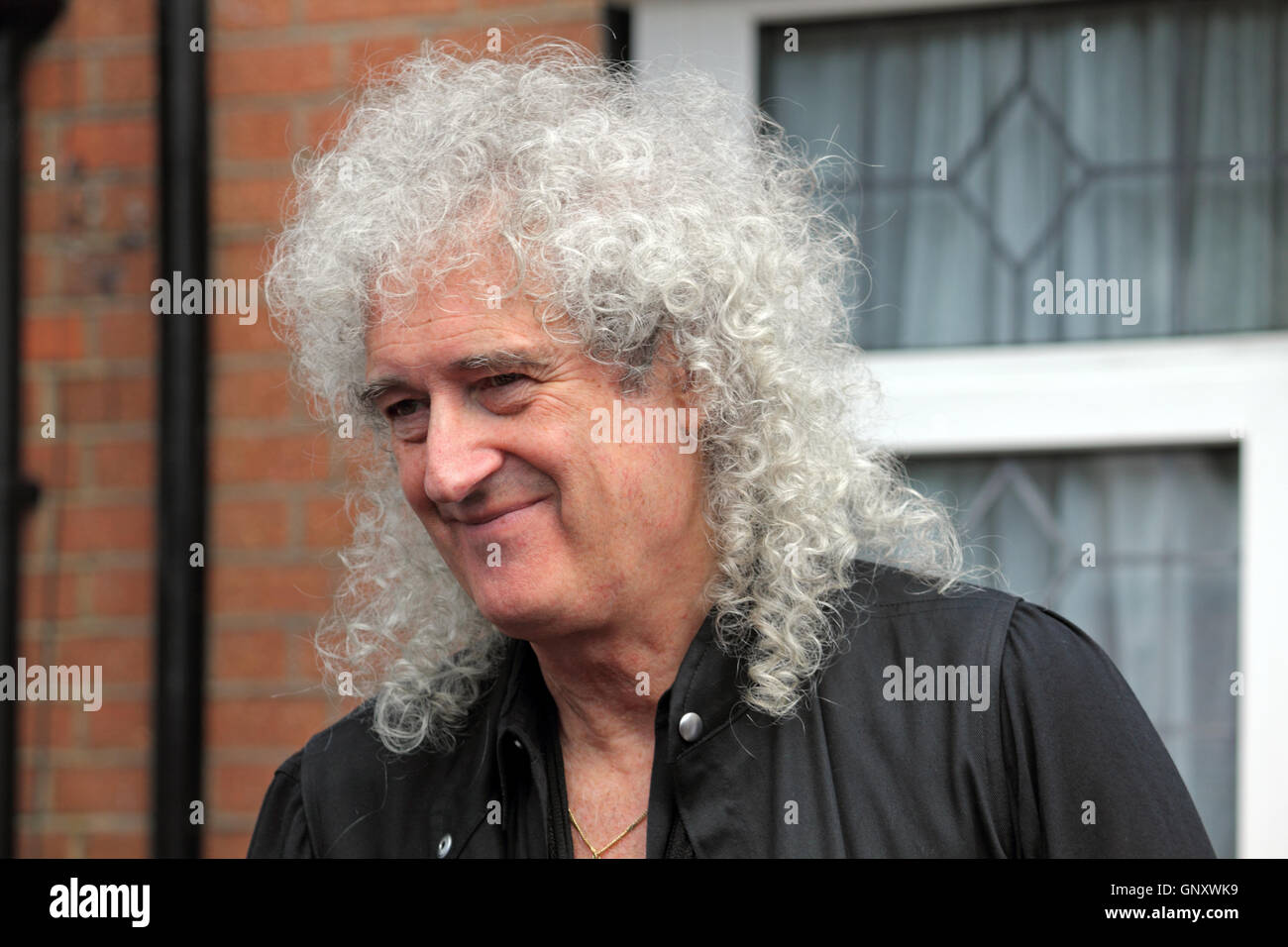 Feltham, London, England, UK. 1st September 2016.  Brian May from rock group Queen unveiled an English Heritage Blue Plaque for the former lead singer Freddie Mercury. On what would have been Freddie's 70th birthday the Blue Plaque showing his birth name Fred Bulsara was unveiled on his former home at Feltham in West London, where he lived with his family in the 1970's. Credit:  Julia Gavin UK/Alamy Live News Stock Photo