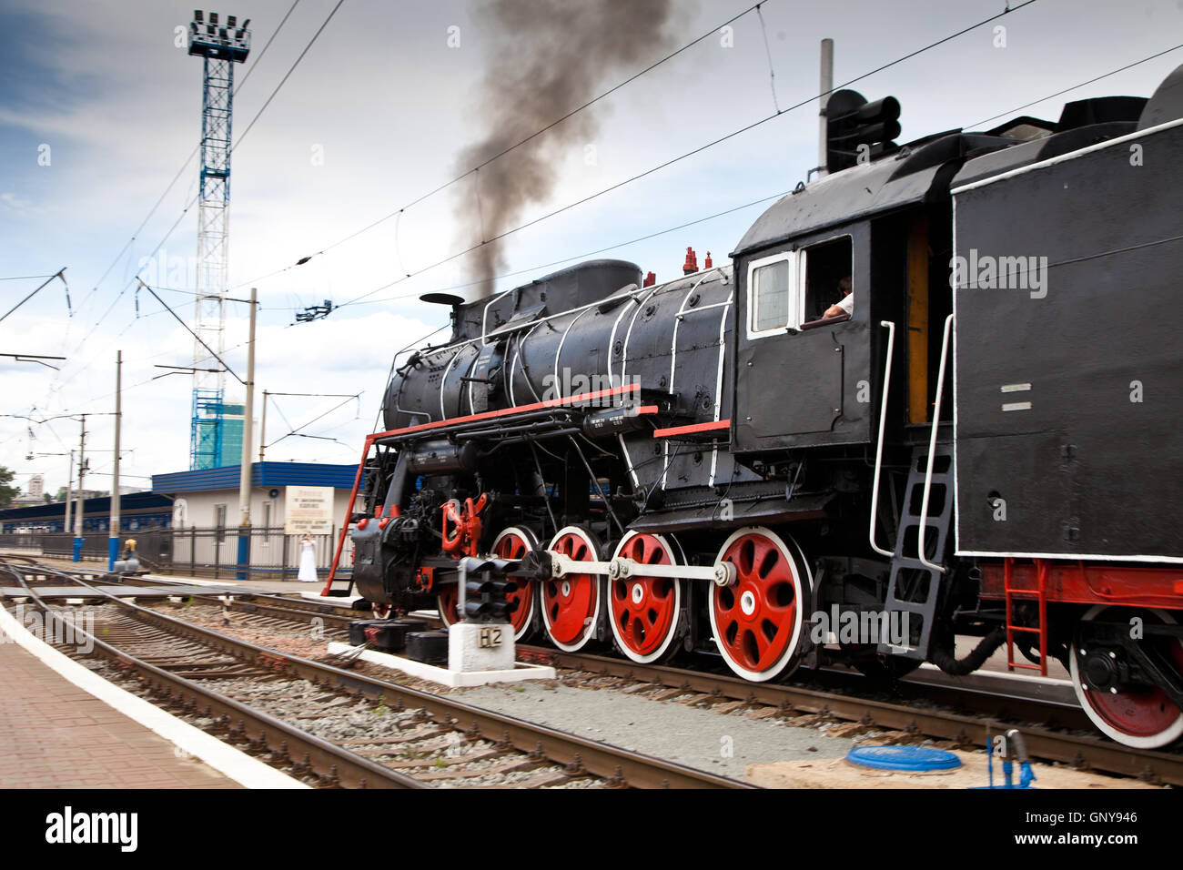 Old steam train is leaving a station Stock Photo