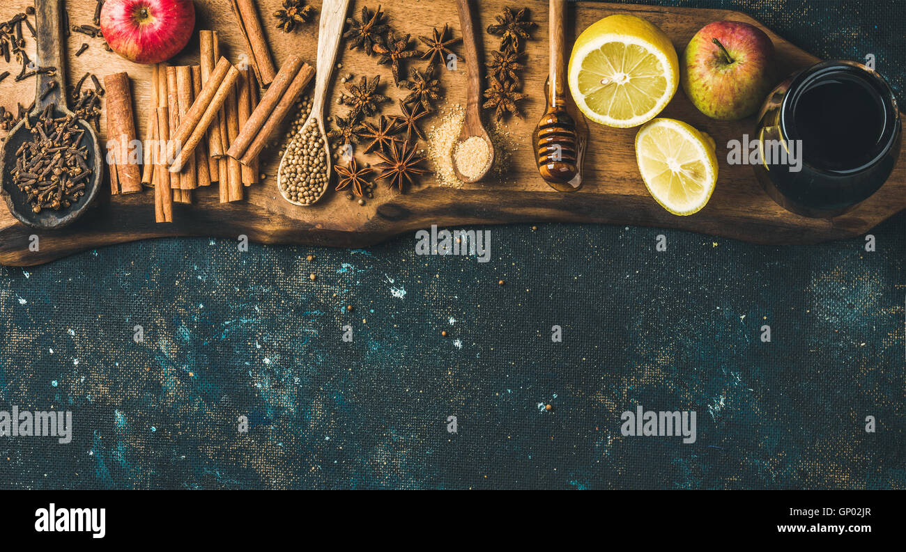 Ingredients for making mulled wine over blue painted plywood background - Stock Image