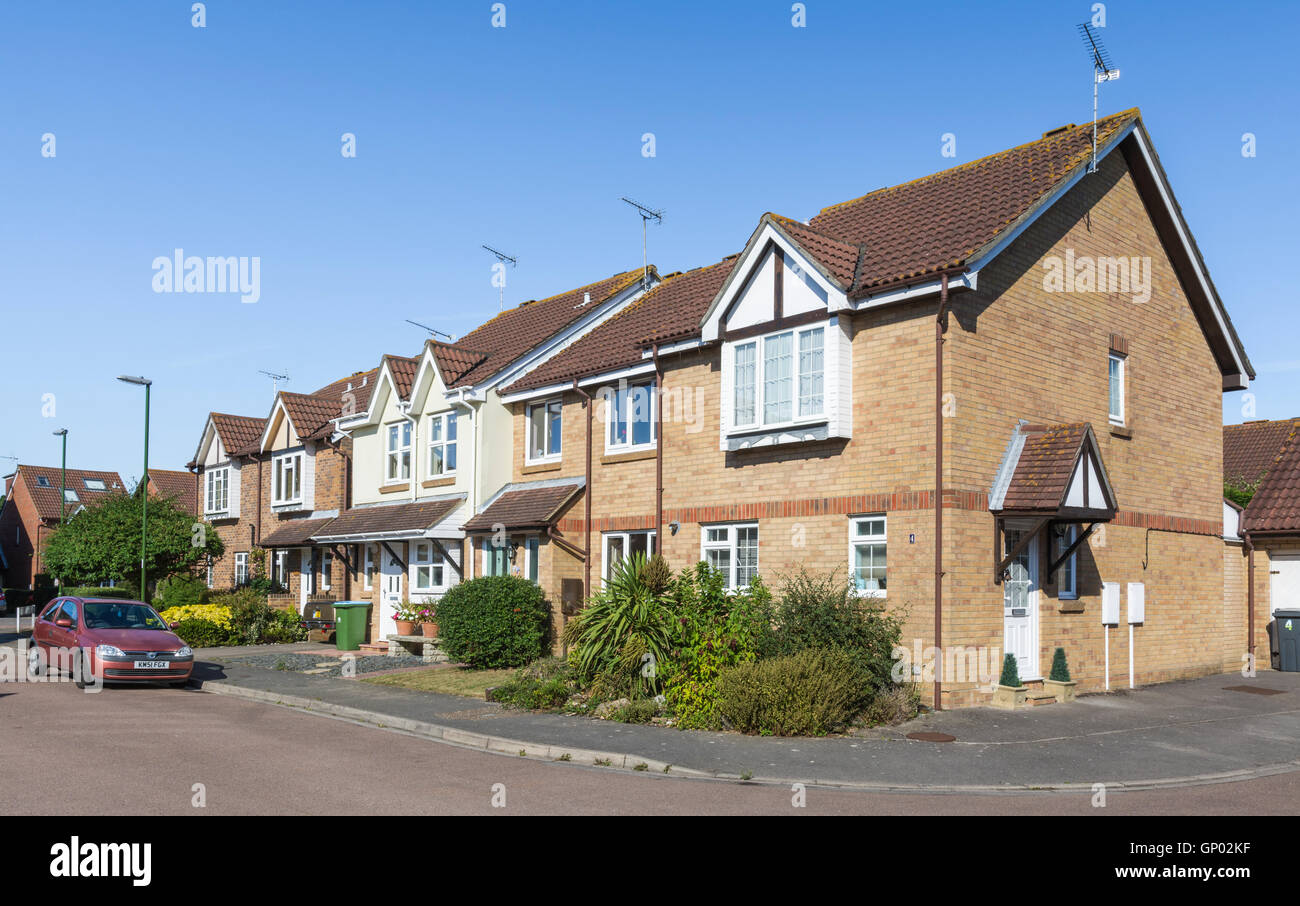 Terrace of houses in a quiet residential street in the UK. - Stock Image
