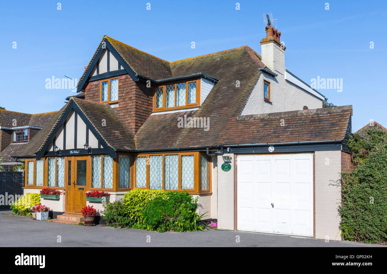 Large 1930s detached house in Mock Tudor style with double glazed windows in West Sussex, England, UK. Stock Photo