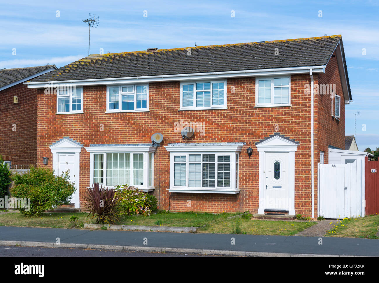 Semi detached modern brick house in the UK. - Stock Image
