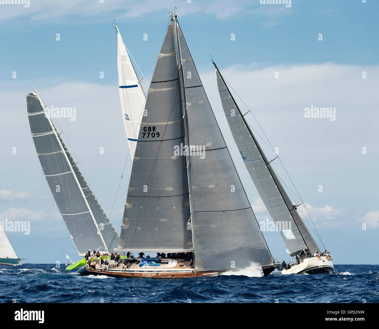 PORTO CERVO - 8 SEPTEMBER: teams competing on Maxi Yacht Rolex Cup sail boat race in Sardinia, on September 8 2015 - Stock Image