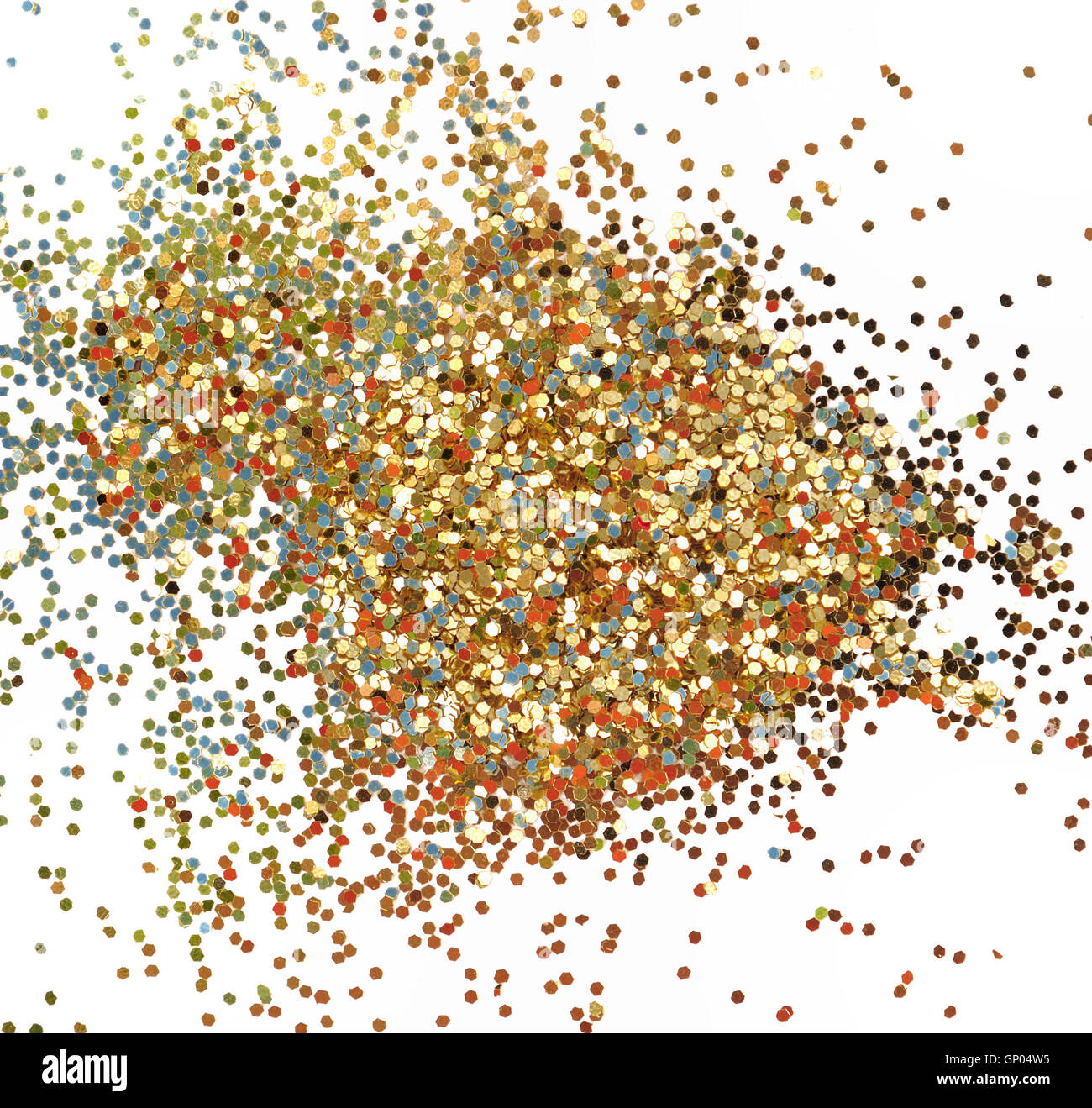 golden glitters scattered on white background - Stock Image