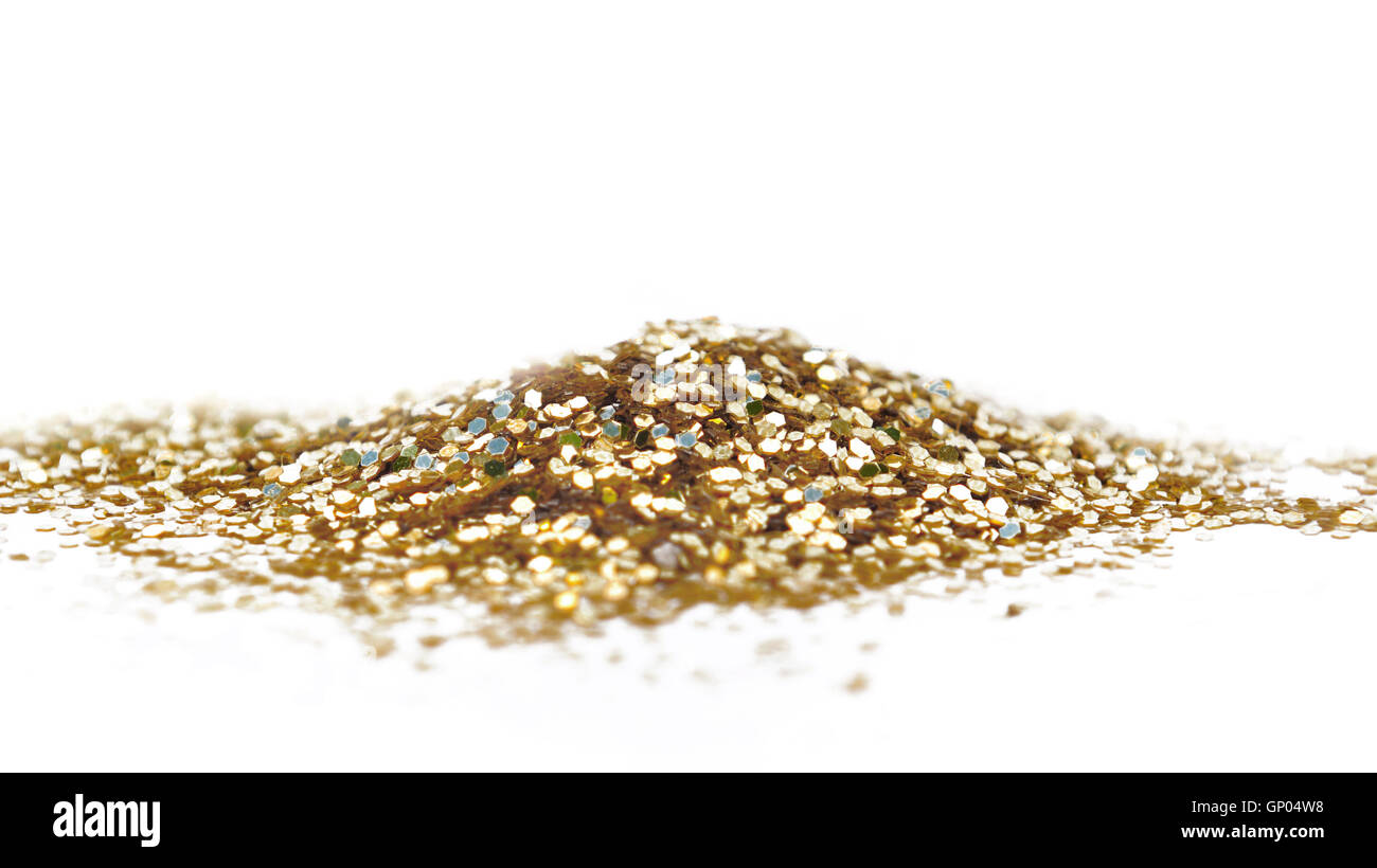 heap of golden glitters on white background - Stock Image