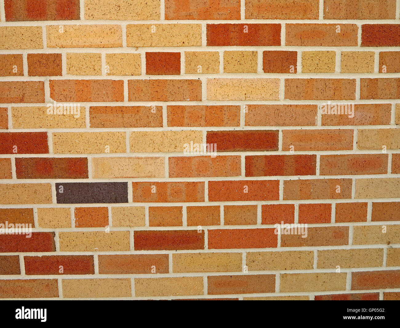 A Brick Wall With Different Color Bricks Stock Photo
