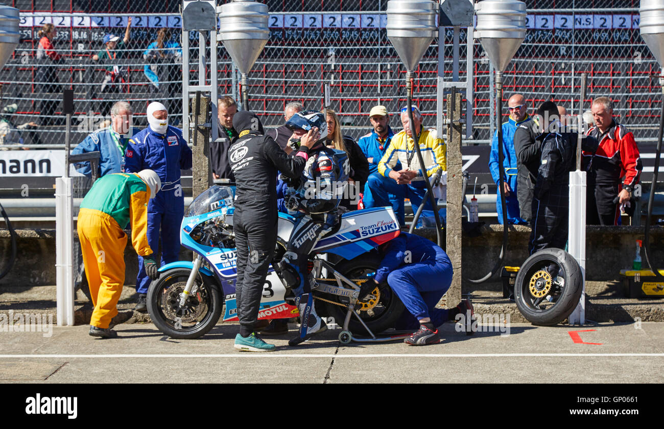 Michael Dunlop, race winner, in the pits having rear wheel changed during the Superbike Classic TT race 2016 Stock Photo